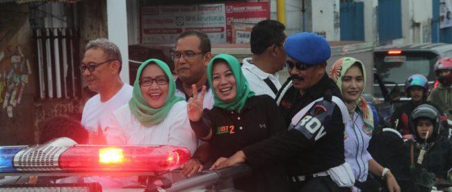 Pasangan Calon Bupati dan Wakil Bupati bogor, Ade Yasin-Iwan Setiawan, saat tiba di Lapangan Curug Dengdeng, Caringin, Kabupaten Bogor, Minggu (22/4/2018)